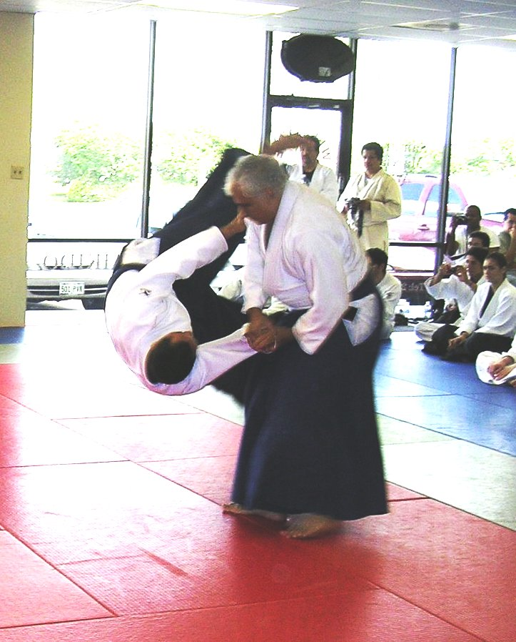Dr. Jaideep Mukherjee throwing Sensei Albert Pena (uke) as part of his San-dan Test